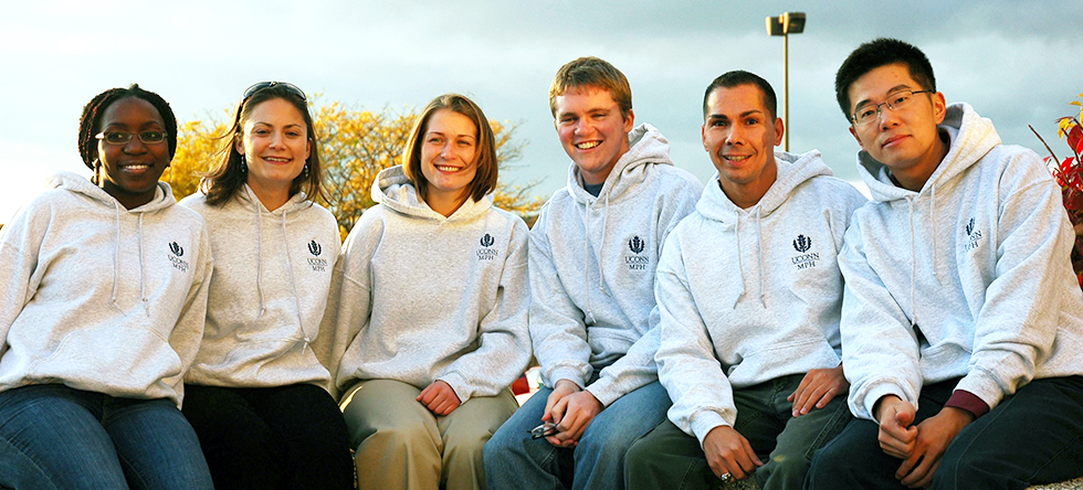 Picture of MPH Students sitting outside with MPH sweatshirts